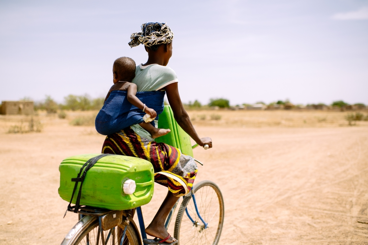 Woman and child on bicycle in Western Uganda